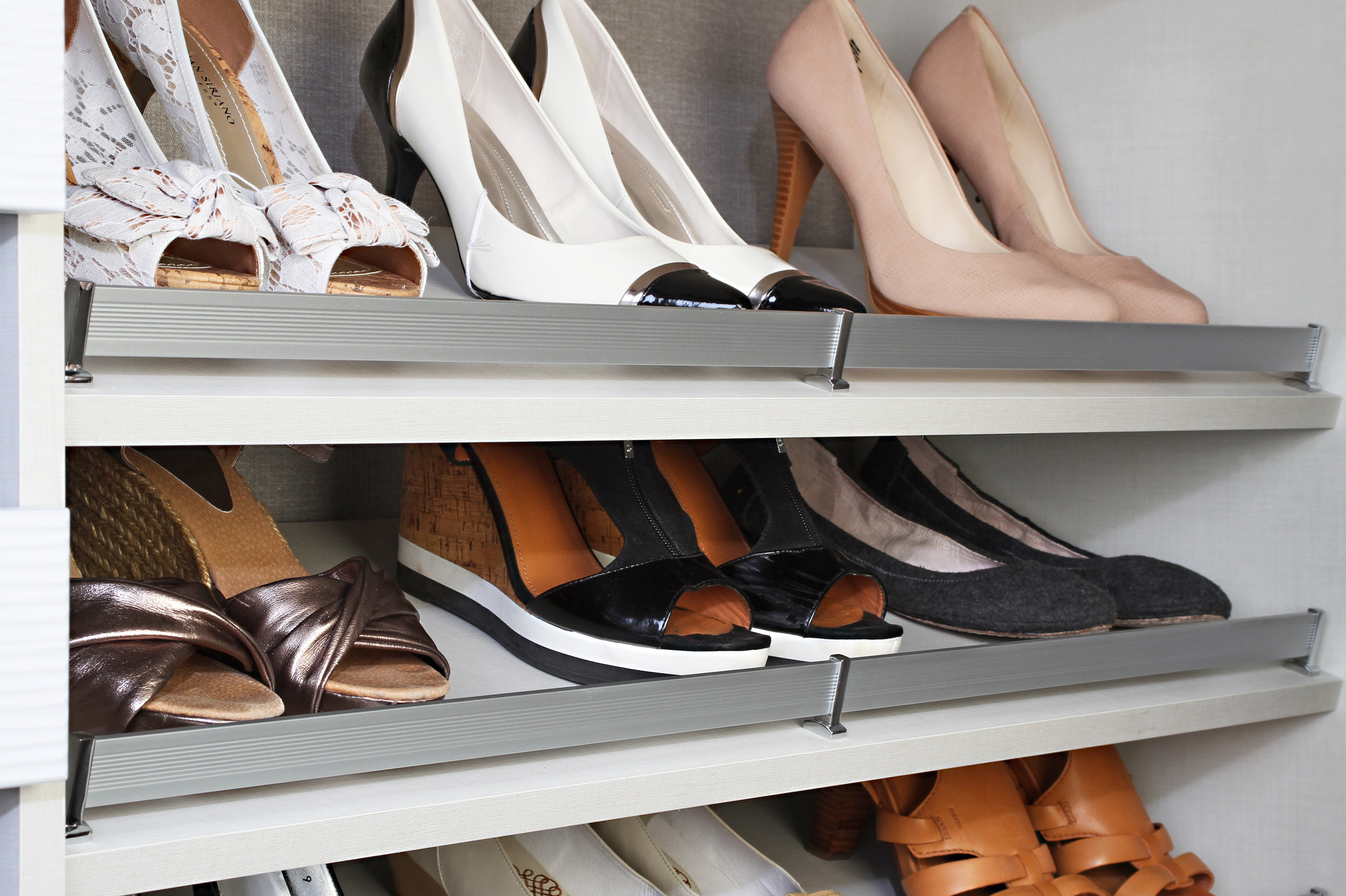 Give your shoe rack a clean, organized look with shoe fences by TAG Hardware.  Call Closets of Tulsa  now for your FREE consultation and 3-D closet design:  918.609.0214 .