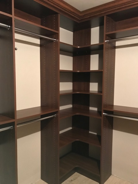 Continuous corner shelving and crown molding give this custom closet by Closets of Tulsa a luxurious look.  Call now  for a FREE consultation and 3-D closet design:  918.609.0214