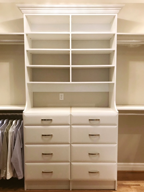 Crown molding creates a striking focal point in this custom closet by Closets of Tulsa.  Call now  for a FREE consultation and 3-D closet design:  918.609.0214