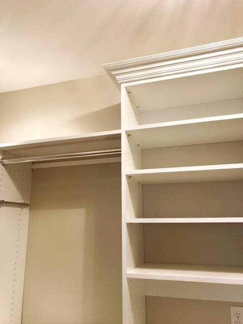 Open storage shelves flank a central cabinet with crown molding in this custom closet by Closets of Tulsa.  Call now  for a FREE consultation and 3-D closet design:  918.609.0214