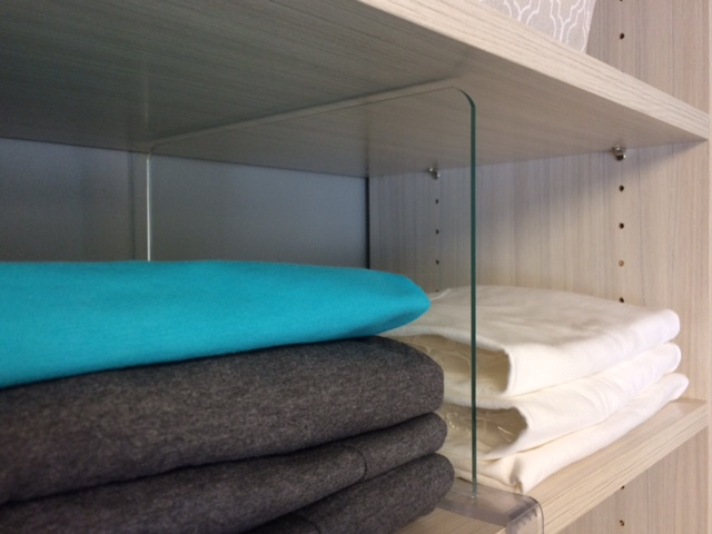 Acrylic shelf dividers by Closets of Tulsa add minimalist structure to your closet organizer.  Call now  for a FREE consultation and 3-D closet design:  918.609.0214