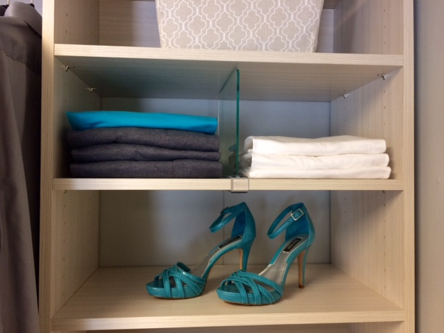 Acrylic shelf dividers by Closets of Tulsa keep sweaters, purses and other items neatly organized.  Call now  for a FREE consultation and 3-D closet design:  918.609.0214