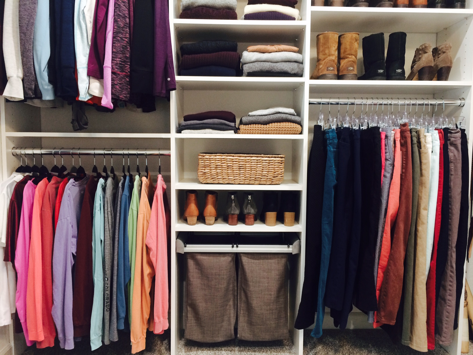 Generous hanging space and pullout laundry hampers make this custom closet easy to maintain.  Call Closets of Tulsa  for a FREE consultation and 3-D closet design:  918.609.0214