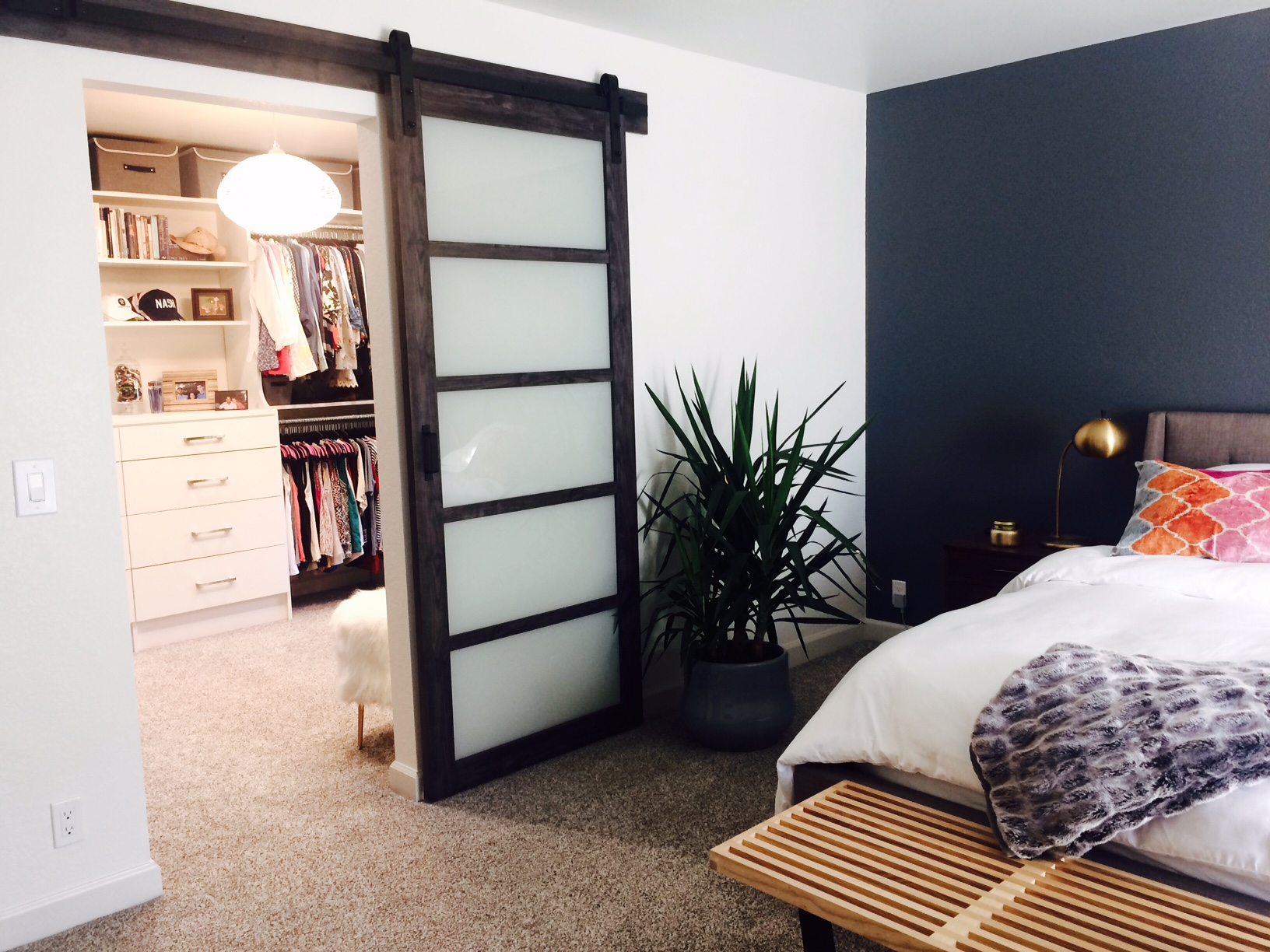 This spacious master closet by Closets of Tulsa was once a small spare bedroom with a separate entry.  Call Closets of Tulsa  now for your FREE consultation and 3-D closet design:  918.609.0214