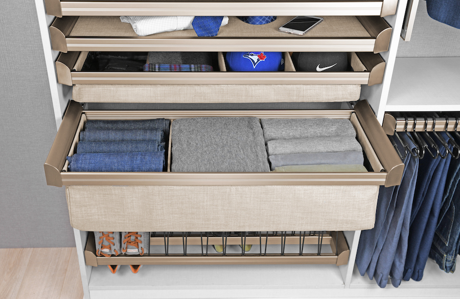 Soft close drawers and drawer dividers by Closets of Tulsa organize clothing and accessories in neat stacks and rows.  Call now  for your FREE consultation and 3-D closet design:  918.609.0214