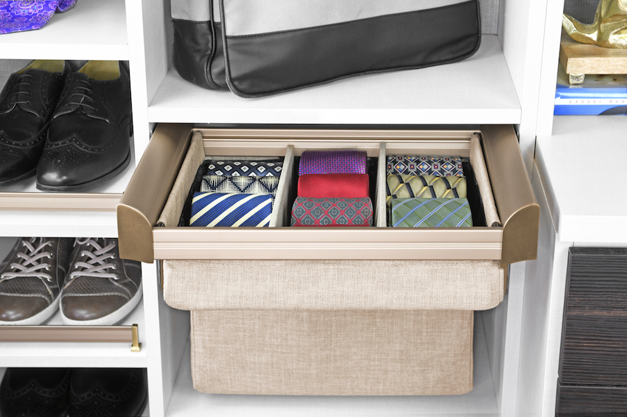 For boutique-style tie storage, try shallow drawers with drawer dividers.  Call Closets of Tulsa  now for your FREE consultation and 3-D closet design:  918.609.0214