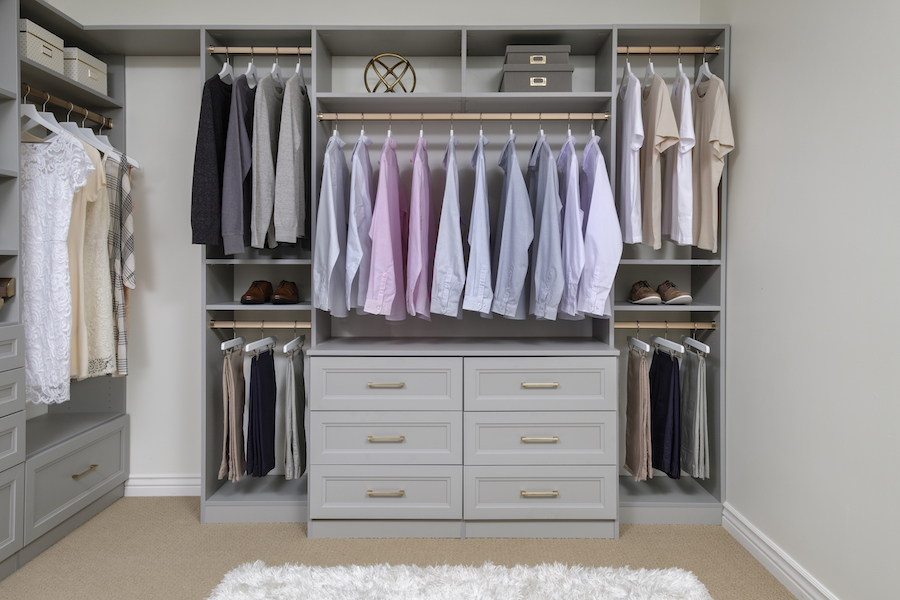 Matte gold closet hardware elevates your custom closet design with subtle sparkle.  Call Closets of Tulsa  now for your FREE consultation and 3-D closet design:  918.609.0214