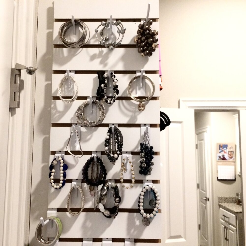 A custom slat wall is a convenient, low-profile solution for jewelry storage. Call Closets of Tulsa today for a  FREE virtual consultation and 3-D closet design :  918.609.0214