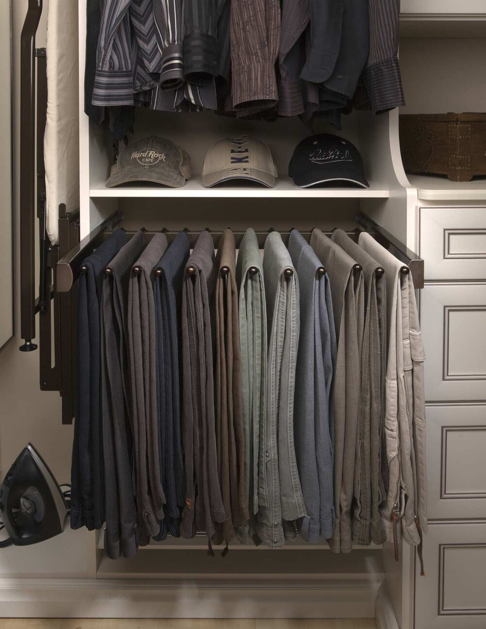 This minimalist slide out pants rack by Closets of Tulsa is shown in Oil Rubbed Bronze. Call now for a  FREE virtual consultation and 3-D closet design :  918.609.0214