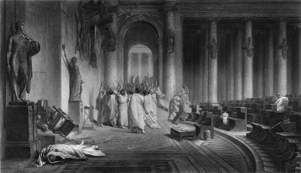 15th March 44 BC, The assassination of Gaius Julius Caesar (c.98 - 44 BC), Roman general and statesman. He was killed on the Ides of March (15th) by a group of senators including Gaius Cassius and Marcus Junius Brutus as he entered the senate house in Rome. Original Artwor (Photo by Edward Gooch/Getty Images)