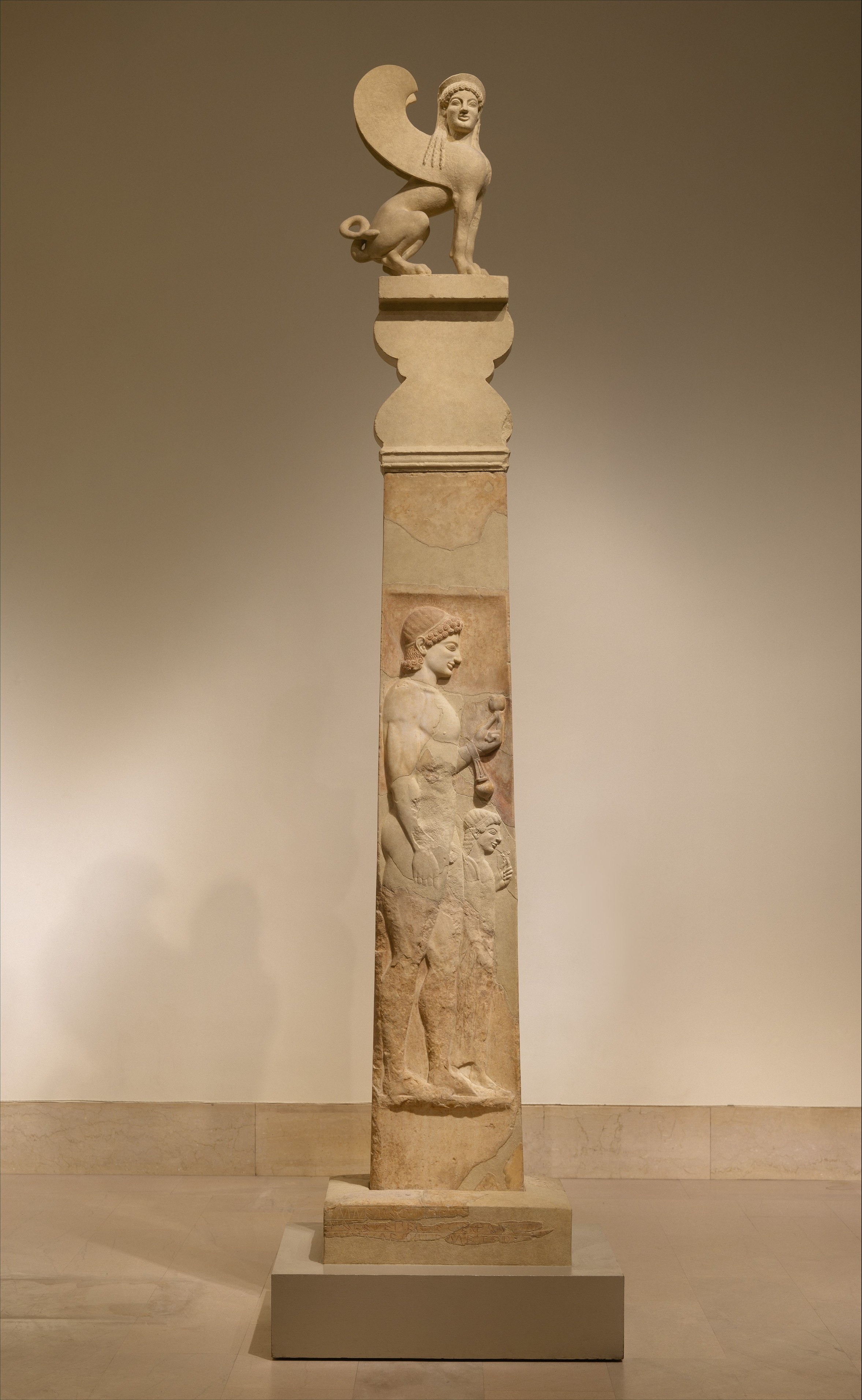 Marble stele of a youth and little girl with capital and finial in the form of a Sphinx