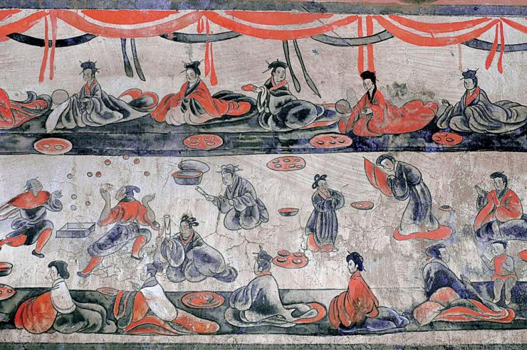 Eric Connor,  Dahuting Tomb Banquet Scene with Jugglers , Eastern Han Dynasty Mural (18 October 2016). Public Domain. Alt Text: Photo of a Mural inside the Dahuting Tomb depicting a banquet scene from the Eastern Han Dynasty. Male and female guests sit in rows on the floor with large plates of food in front of them and there are jugglers there to entertain them.
