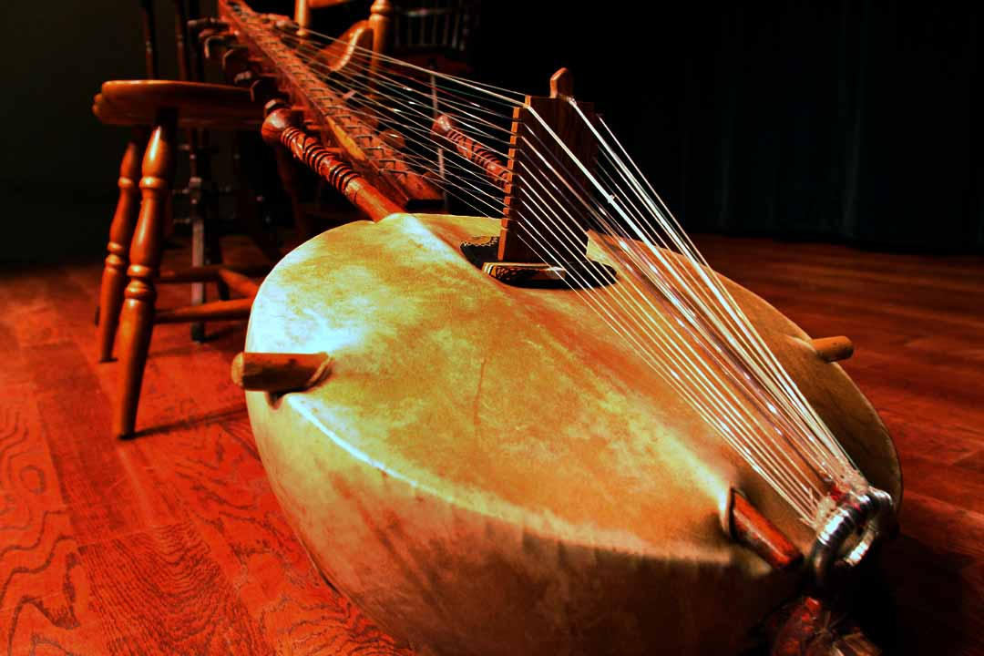 The Kora, is a string instrument with a round body and long neck used by the Griots who are storytellers in the Mande region from past till present.