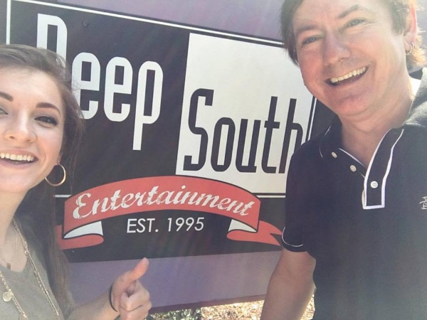 President Dave Rose and Account Manager Mandelyn Monchick in front of the Deep South office sign at the Nashville office on Music Row.