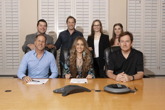 Picture Credit:  MusicRow.com    Pictured: Back Row (L-R): Colton McGee, Director of Business and Legal Affairs, BBR Music Group; Kent Marcus, Marcus & Colvin, LLP; Sara Knabe, VP of A&R, BBR Music Group; Mandelyn Monchick, Deep South Entertainment. Front Row (L-R): Jon Loba, EVP, BBR Music Group; Lainey Wilson; Dave Rose, Deep South Entertainment