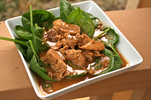 peanut chicken on spinach
