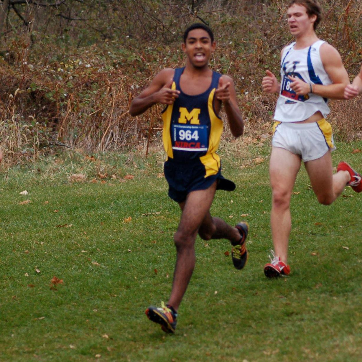 John running Cross Country for UMich