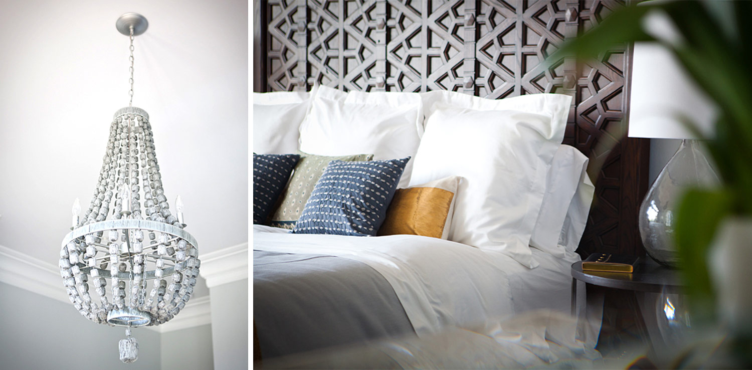 white chandelier, bed, wood headboard, throw pillows