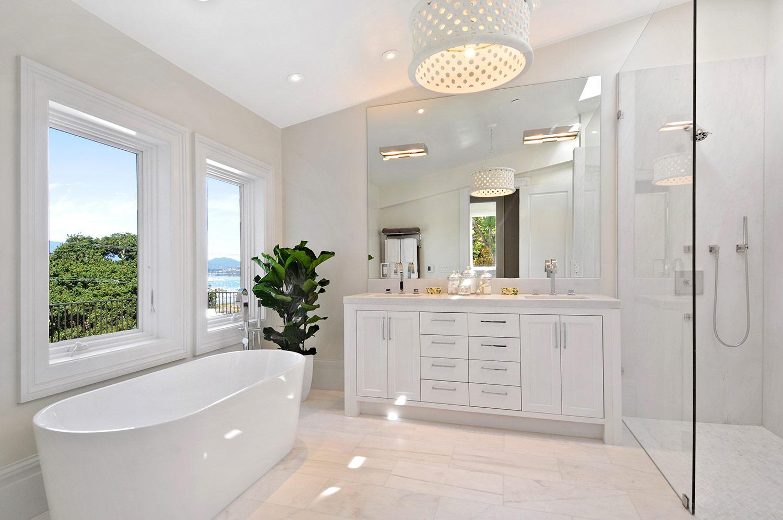 indoor plants, fiddle leaf fig, bathroom, modern bath, tub, vanity, his and hers sinks, bathroom cabinetry, cabinet pulls, shower, tile flooring, marble shower walls