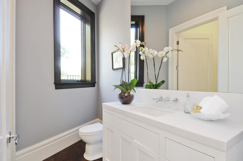 window trim, modern bath, small bathroom design, angled bathroom design, bathroom vanity, bathroom sink, polished chrome faucet