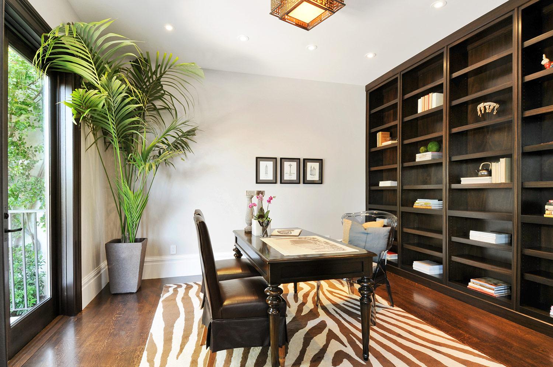 library, office, desk, work space, meeting room, built in shelving, book shelves, hardwood floors, indoor plants