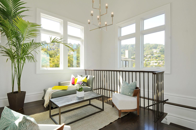 sitting room , reading room, chaise, lounge, attic remodel, natural light, hardwood floors, stair railing