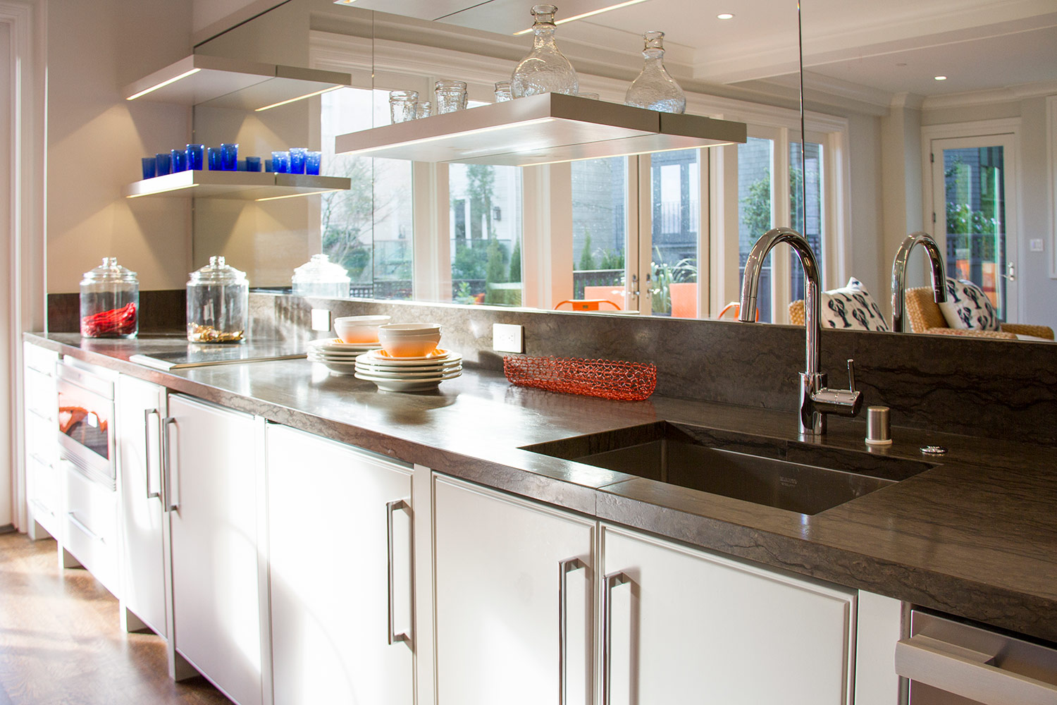 kitchen, countertop, glass, mirror, open cabinets, white, sink, faucet, open shelving
