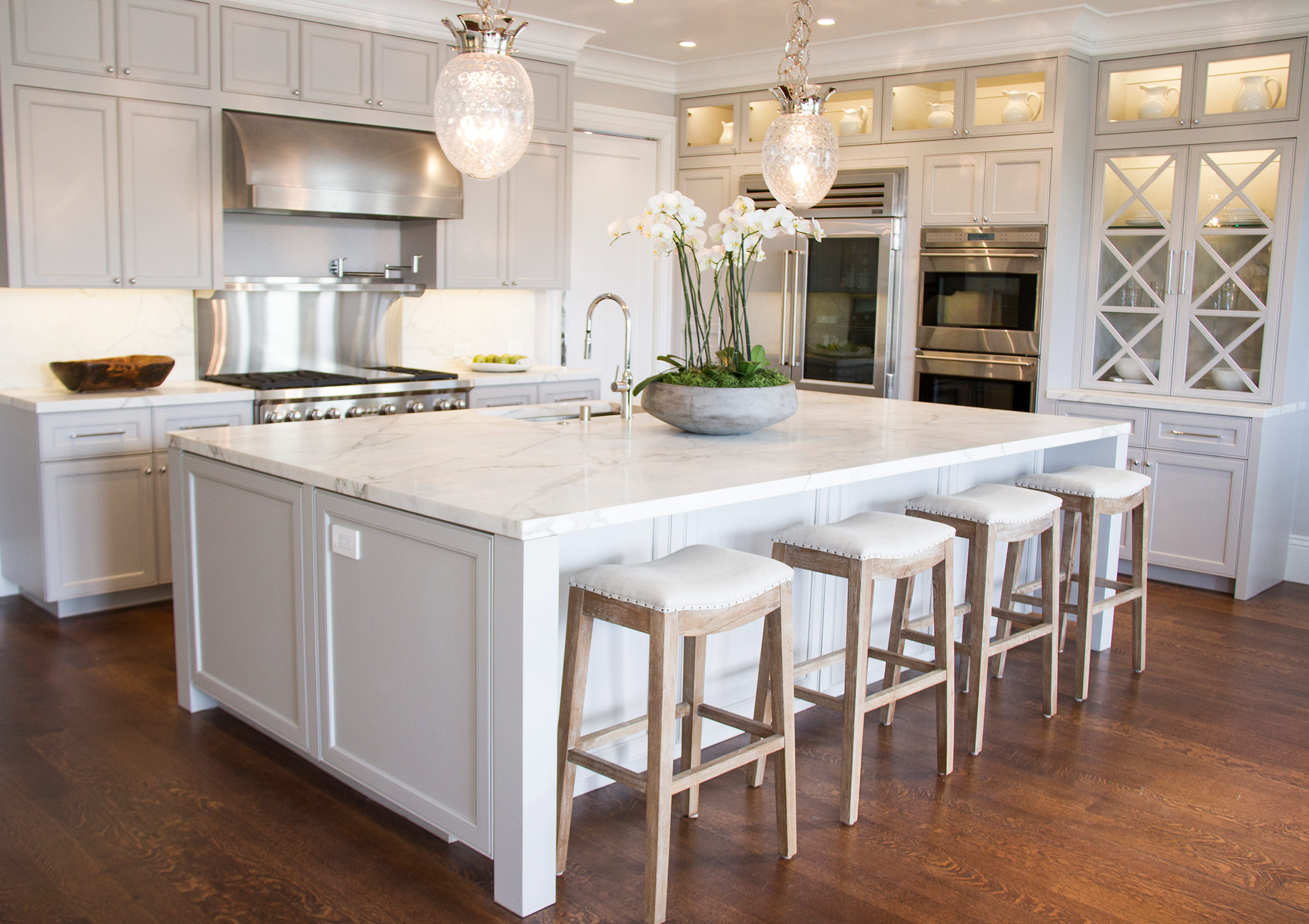 kitchen, simple, white, marble countertop, barstools, cabinets, glass cabinets, stainless steel, appliances, open layout,