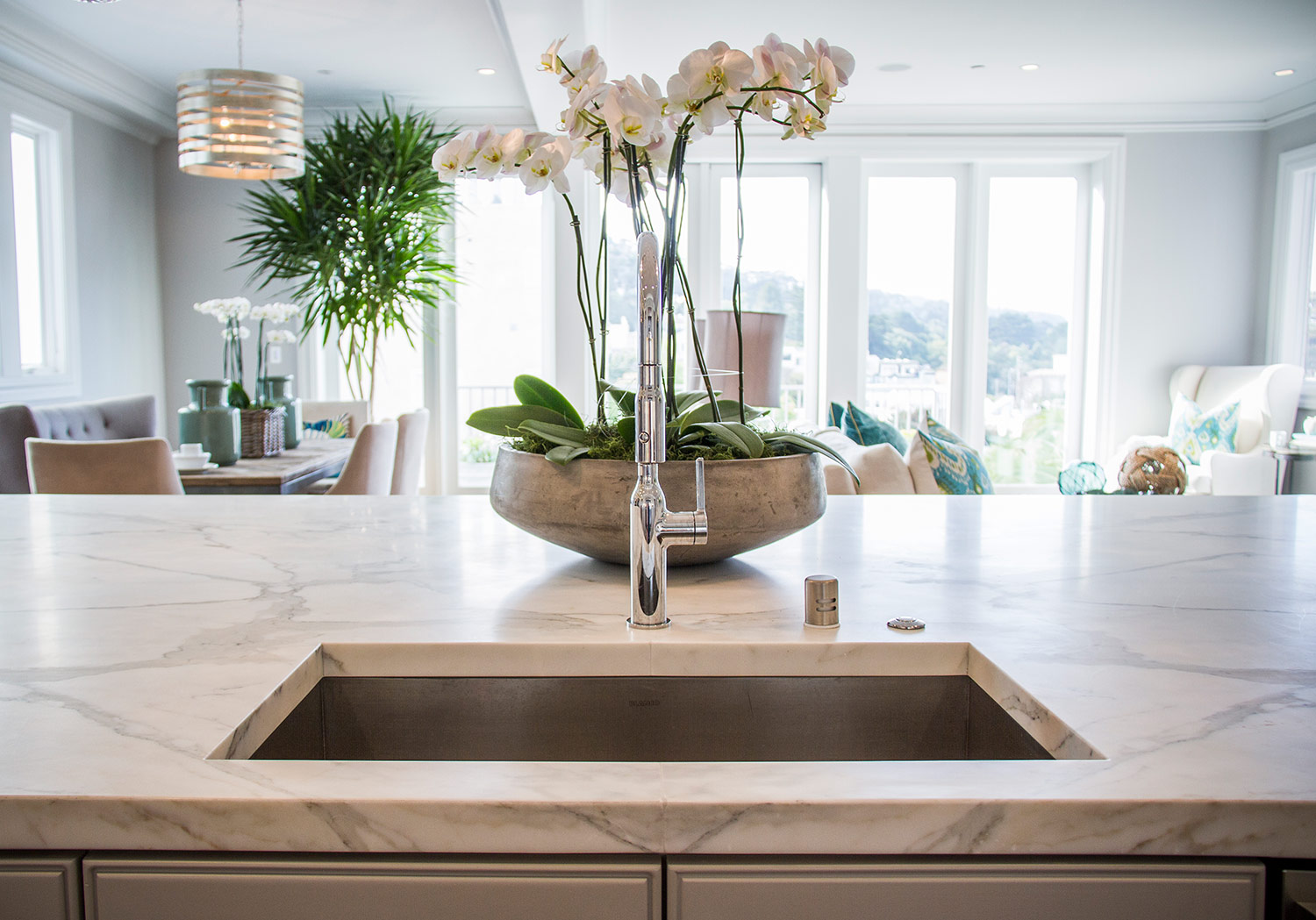 kitchen, marble counters, open space, dining room, detail, chandelier, lighting, open layout, overhead lighting, sink, faucet