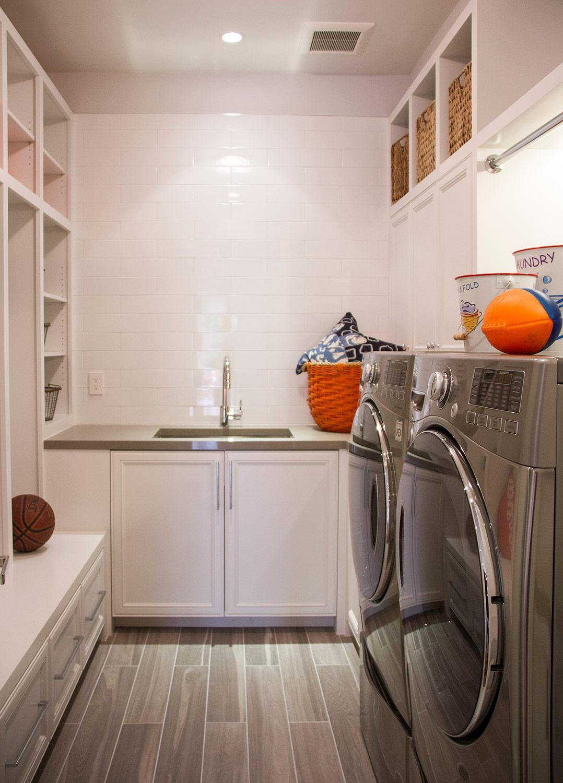 laundry room, washer, dryer, stainless steel, white, backsplash, storage, cabinets