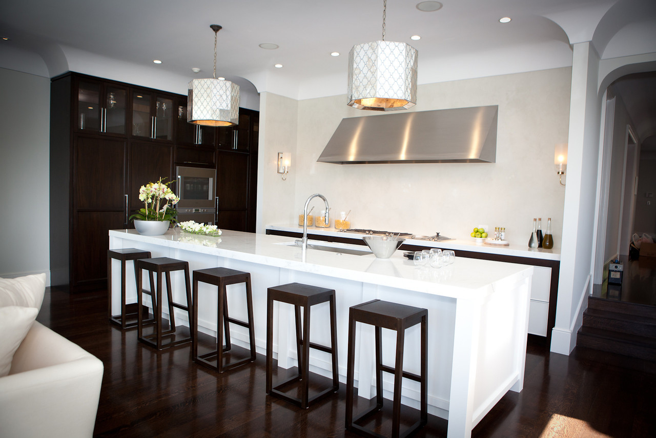 kitchen, modern kitchen, marble counters, stove top, range, stainless steel, kitchen cabinetry, kitchen island, barstools, pendant lights