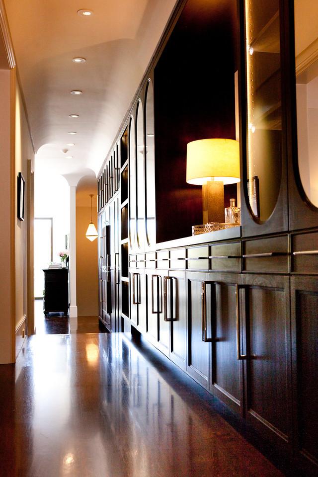 traditional cabinetry, warm tones, hardwood floor, book shelf, library, storage
