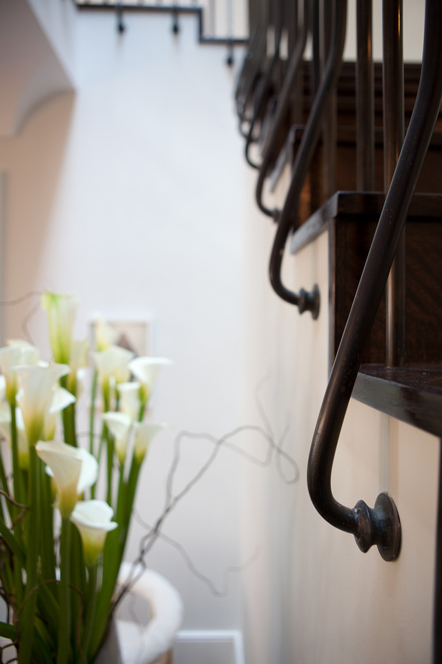 stiarcase detail, metal, iron work, spiral staircase, hardwood floors