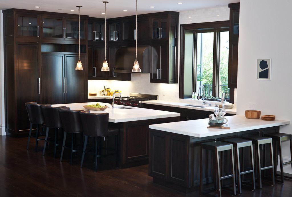 Kitchen, marble counters, barstools, counter stools, kitchen cabinetry, hardwood floors, dark stain