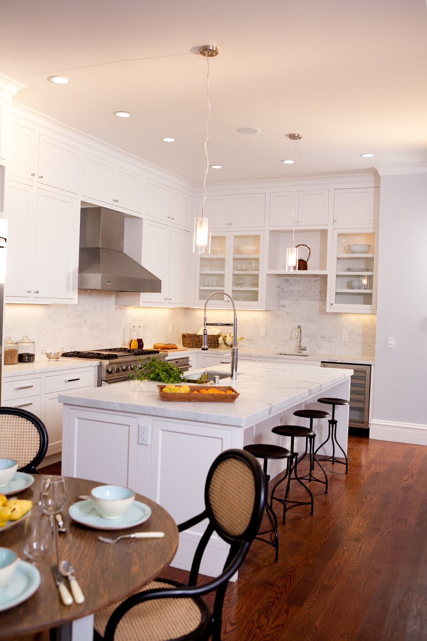 kitchen, bar  stools, breakfast nook, stainless steel appliances, carerra marble counters, subway tile backsplash