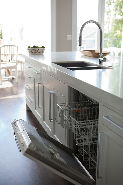 dishwasher, marble counters, polished chrome faucet, double sink