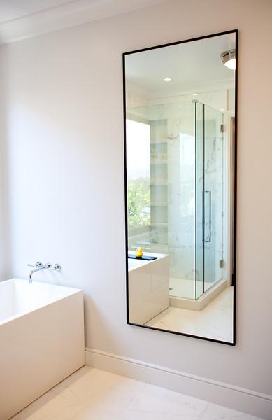 modern tub, mirror, bathroom, shower, faucet