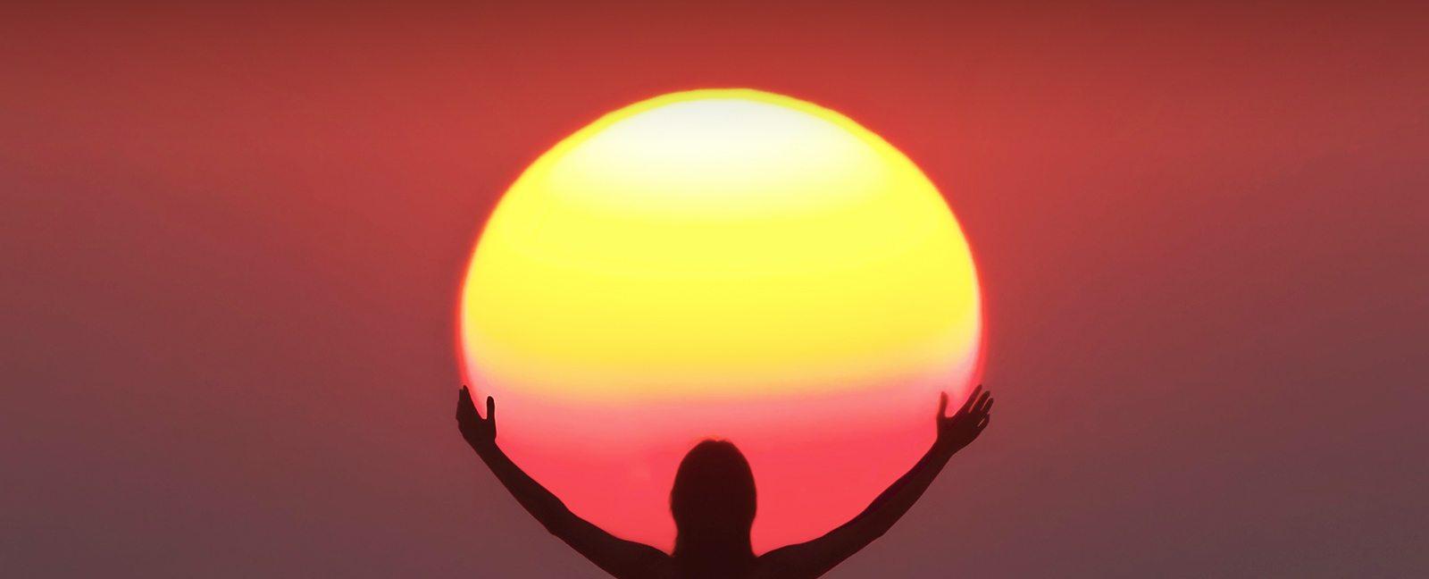 sunrise holding sun.jpg