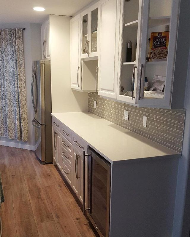 """Honey oak cabinets painted to Benjamin Moore in the colour """"stream""""  AF-15 quartz countertops"""