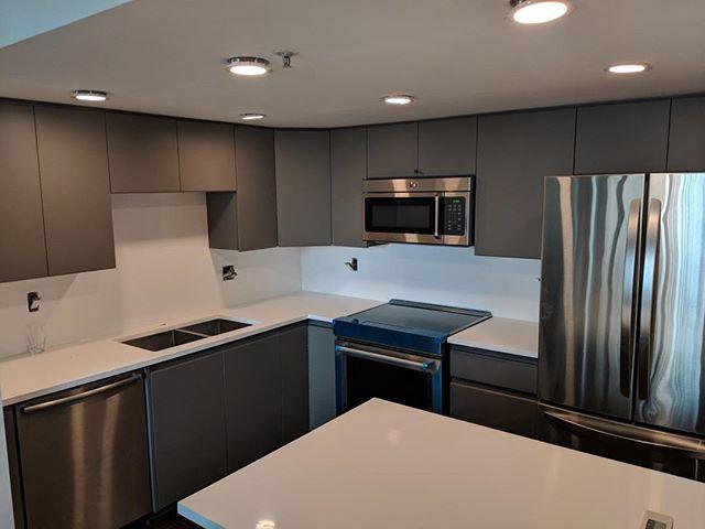 Main Street Kitchen Reno- Gauntlet Gray Matte Doors - Caesar Stone Pure White Quartz Countertops..... #countertops. #cabinetrefacing