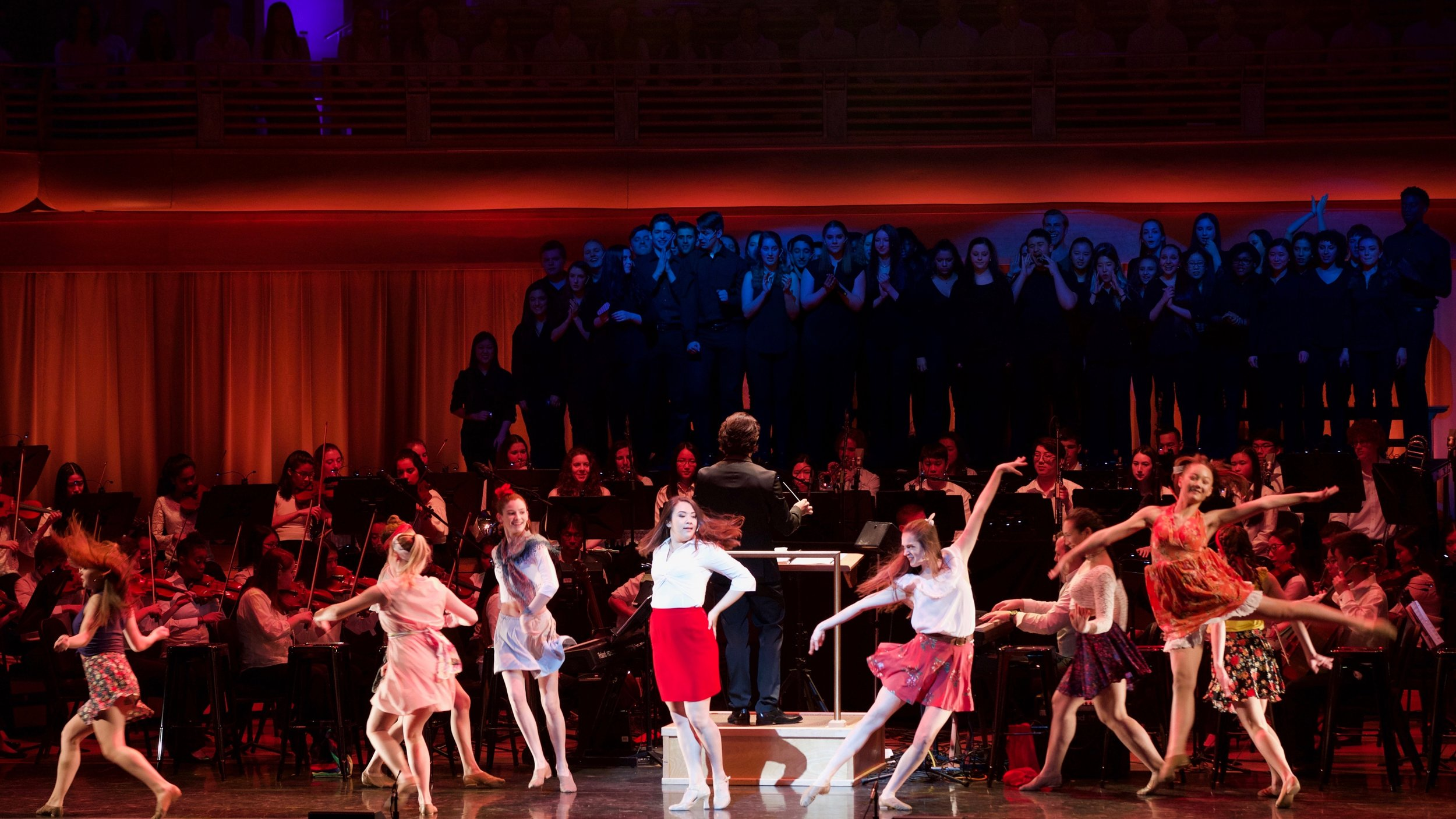 Chani (center in red skirt) on stage at YAA's  The Circle of Life.