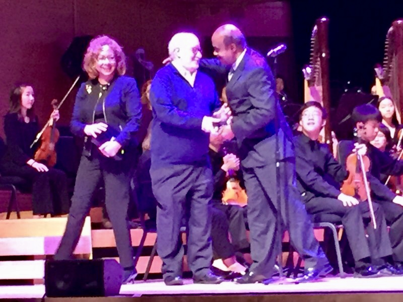 Eliot Pfanstiel accepts the award from Ike Leggett, County Executive.