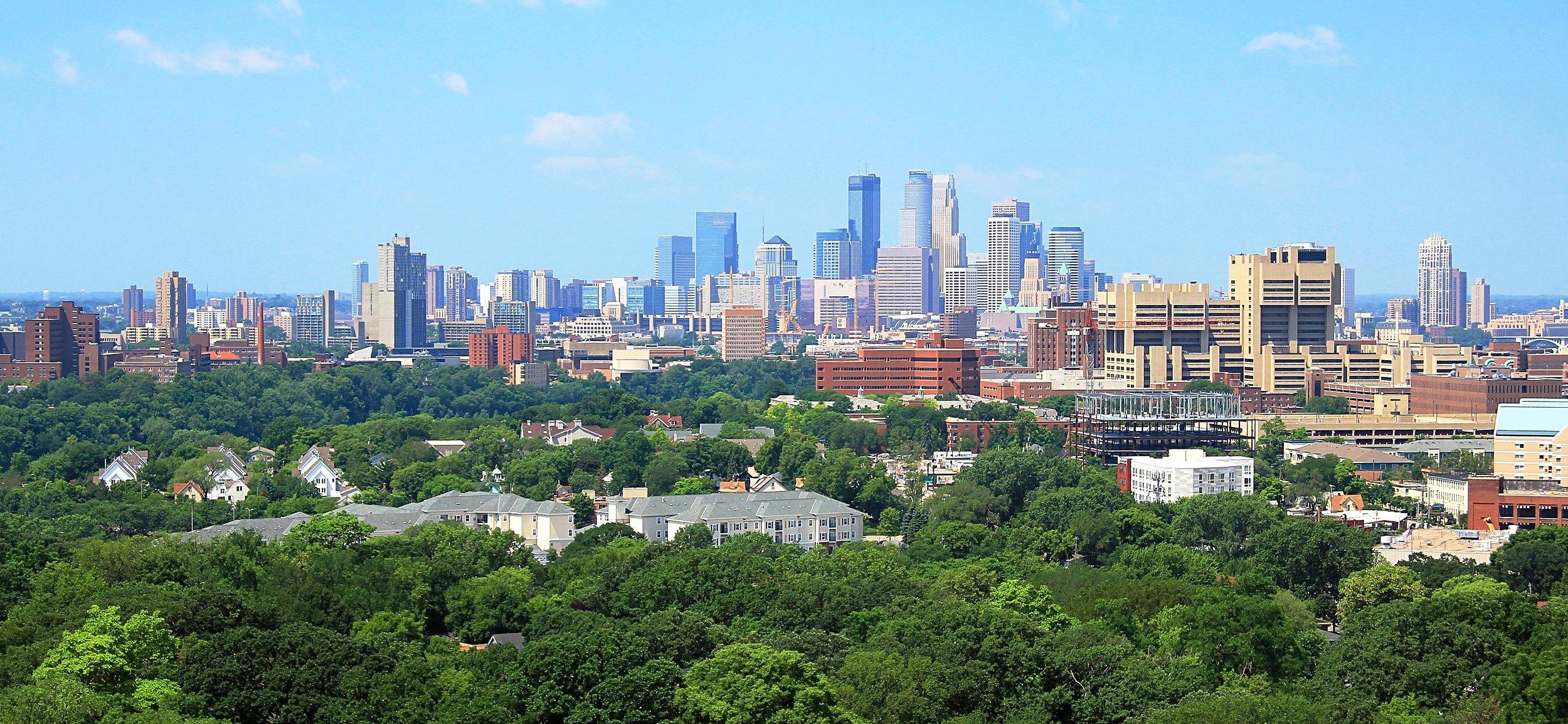 Minneapolis_skyline_from_Prospect_Park_Water_Tower,_July_2014.jpg