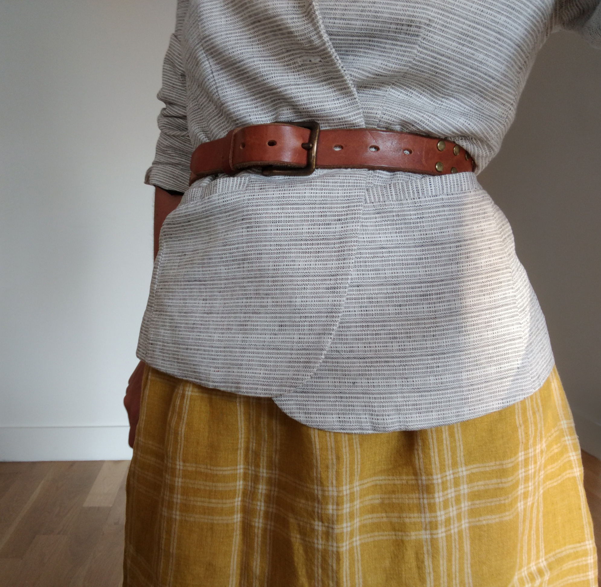 leanne luce texture mix gray melange cotton blazer with a tan leather belt and mustard yellow linen plaid skirt