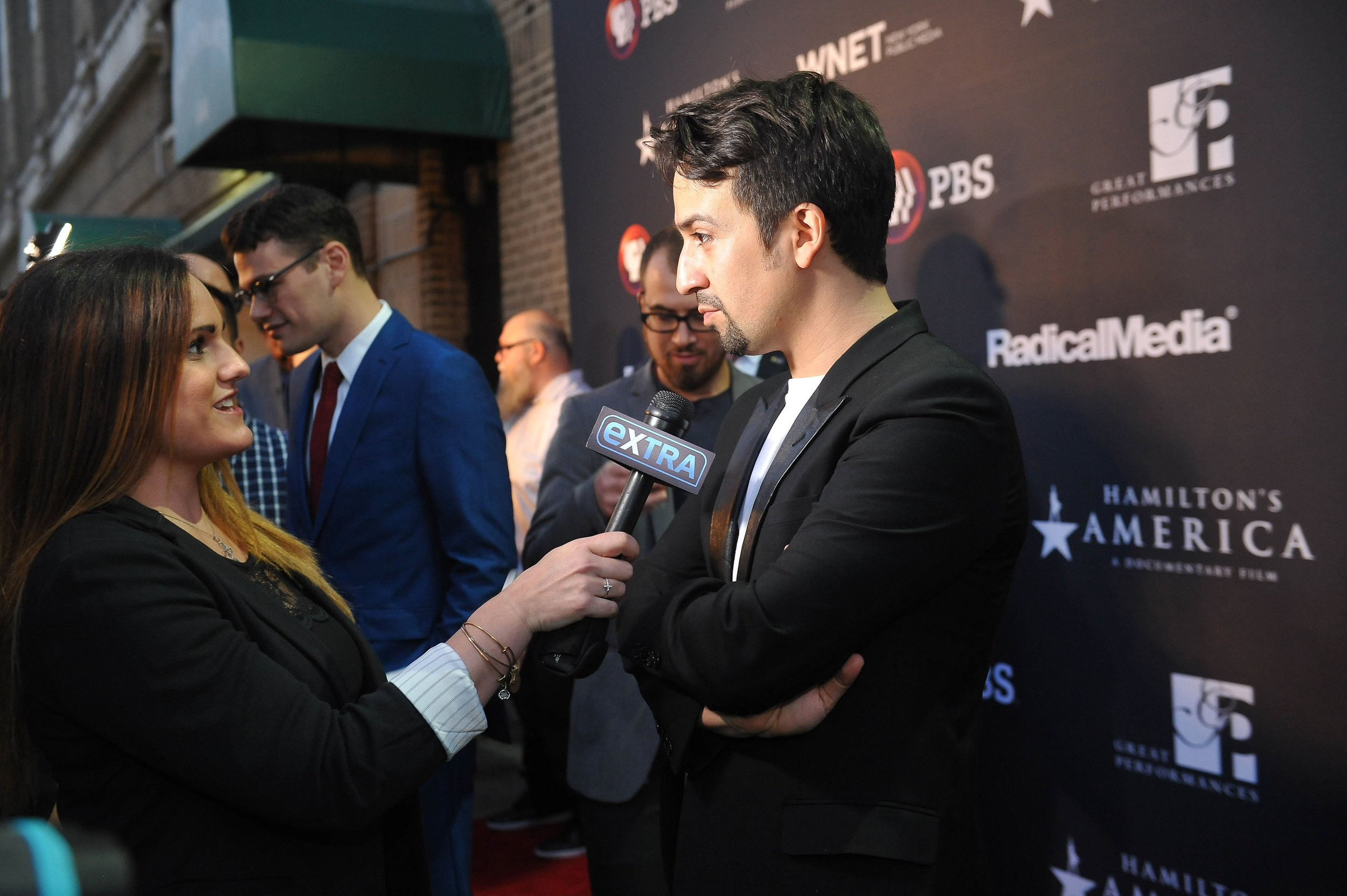 """Lin-Manuel Miranda interviewing with Extra on the red carpet at the official screening of """"Hamilton's America"""" at the Union Palace Theatre in Washington Heights.  ©Stephanie Berger"""