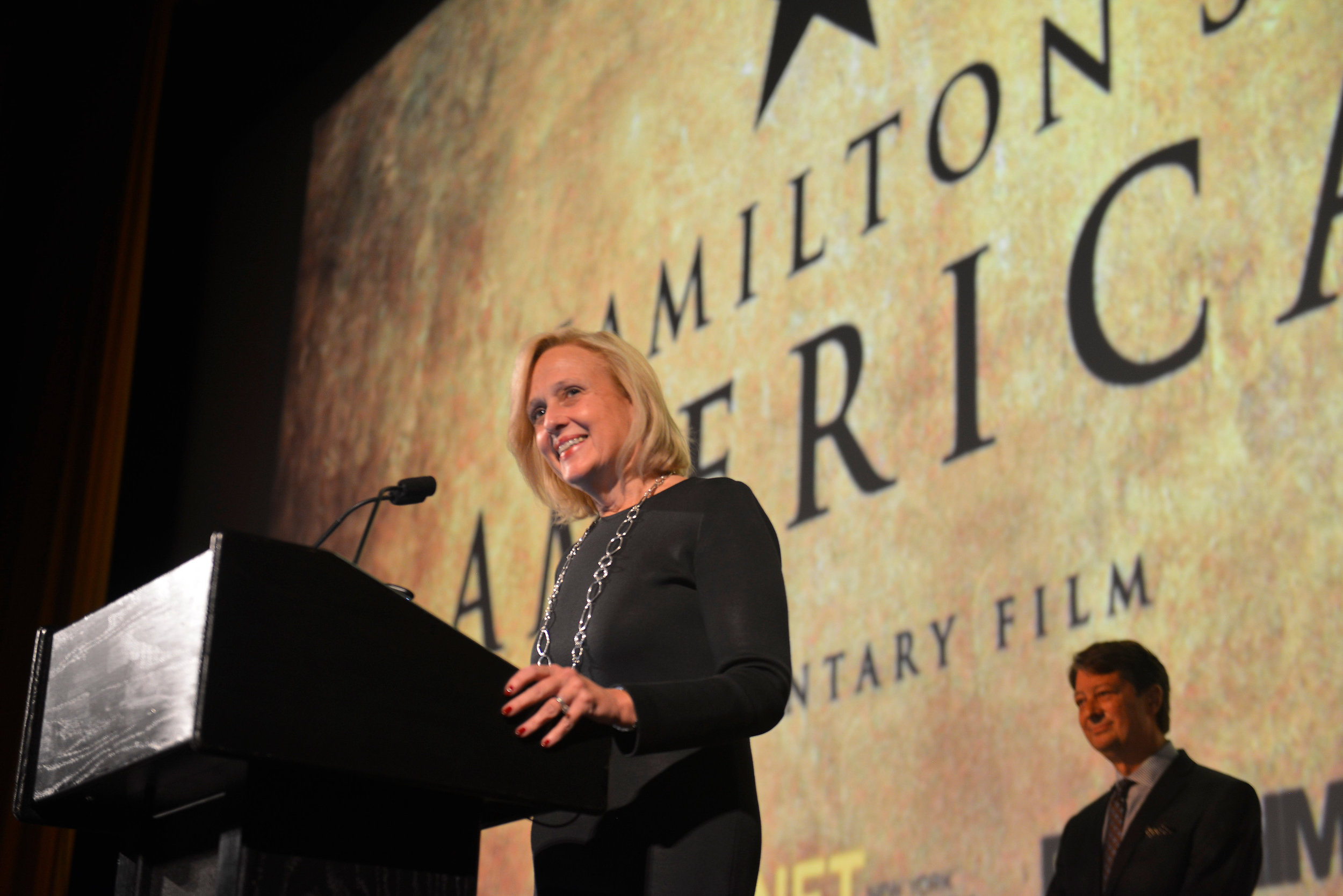 "PBS President and CEO, Paula Kruger gave the opening remarks at the screening of ""Hamilton's America"" last night at the Union Palace Theatre.   ©Stephanie Berger"