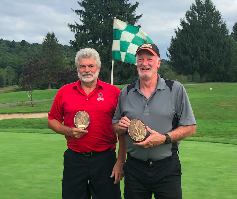 In an exciting finale, John Hartley drains the final putt on 18 green as he and his partner, Hank Middlemas, best the field to win the 2018 Member/Member Championship.