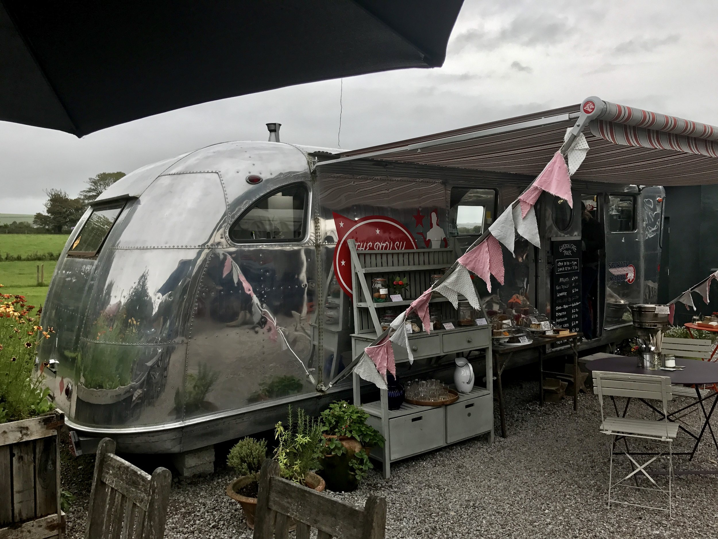 Darina's idea of a food truck and its outdoor café. An old Airstream that has been completely renovated and retrofitted to be a mobile cafe, though they've plumbed it and don't intend to move it. Coolest food truck ever!