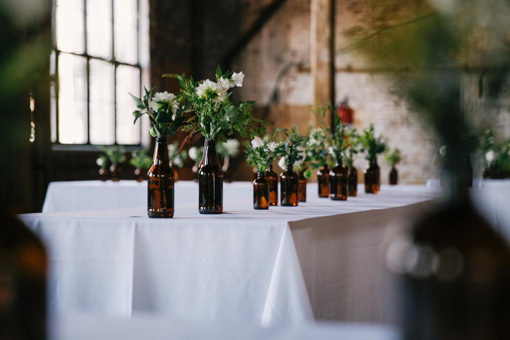 diy-bottles-flowers-brown-and-green-greenpoint-loft-wedding-1024x683.jpg