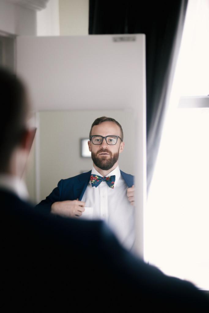 groom-in-mirror-greenpoint-loft-wedding-683x1024.jpg
